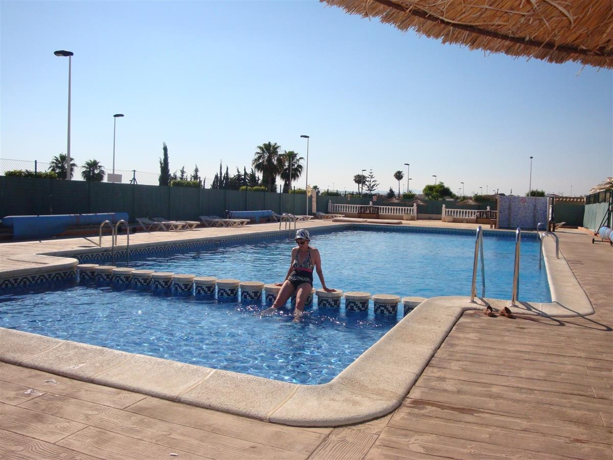 swimming pool from other direction with sunbathing area at end