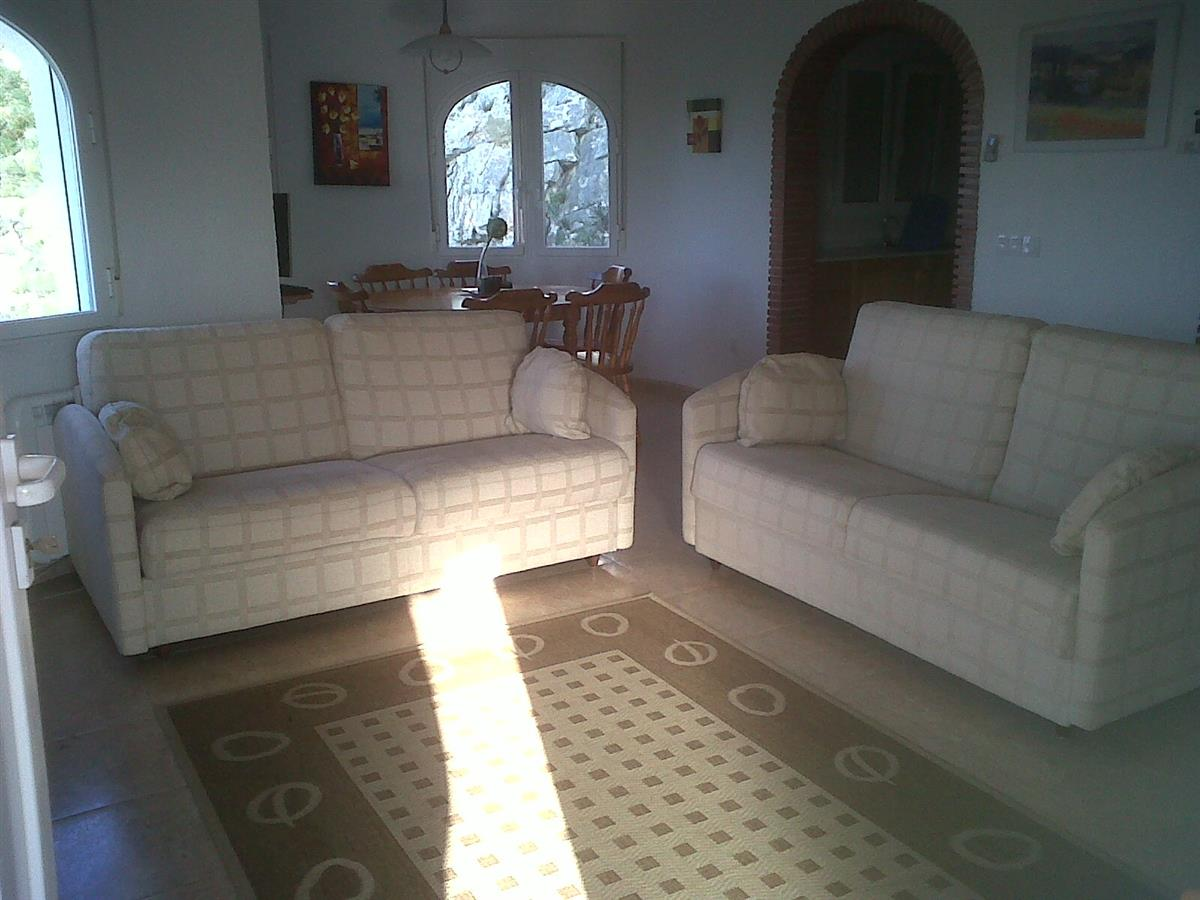 View of the lounge.Lovely comfortable sofas one is a sofa bed.