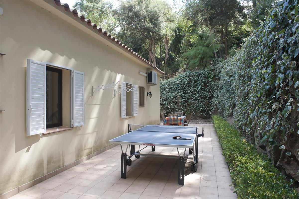rear terrace with seating and table tennis