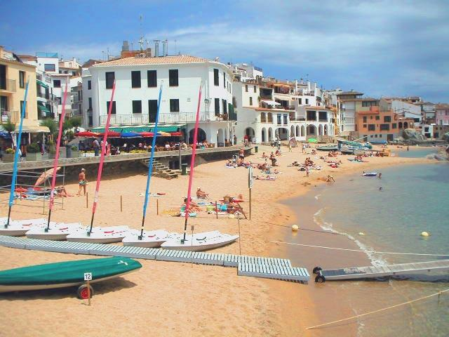 Calella de Palafrugell. Golden sand beaches and boardwalk.