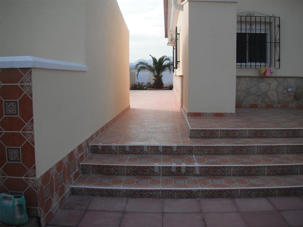 entrance from pool area to rear garden area