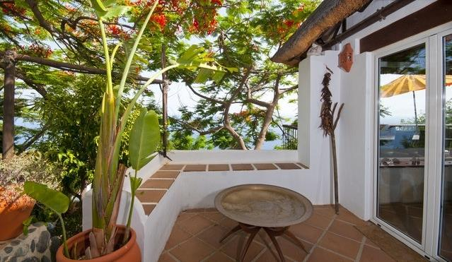 Lush tropical gardens surround the house giving plenty of shade