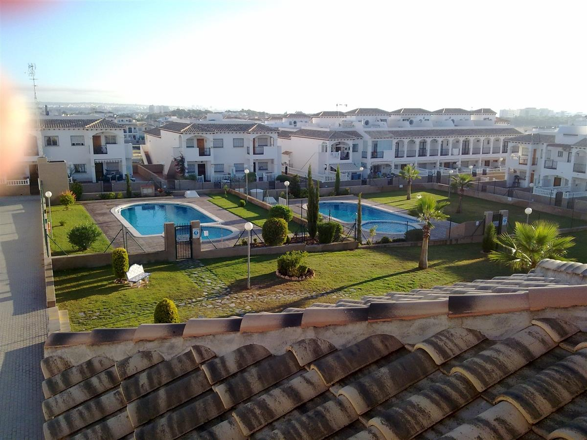 View of Garden and 2 Communal Pools