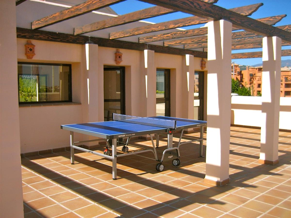 Table tennis table next to outdoor pool