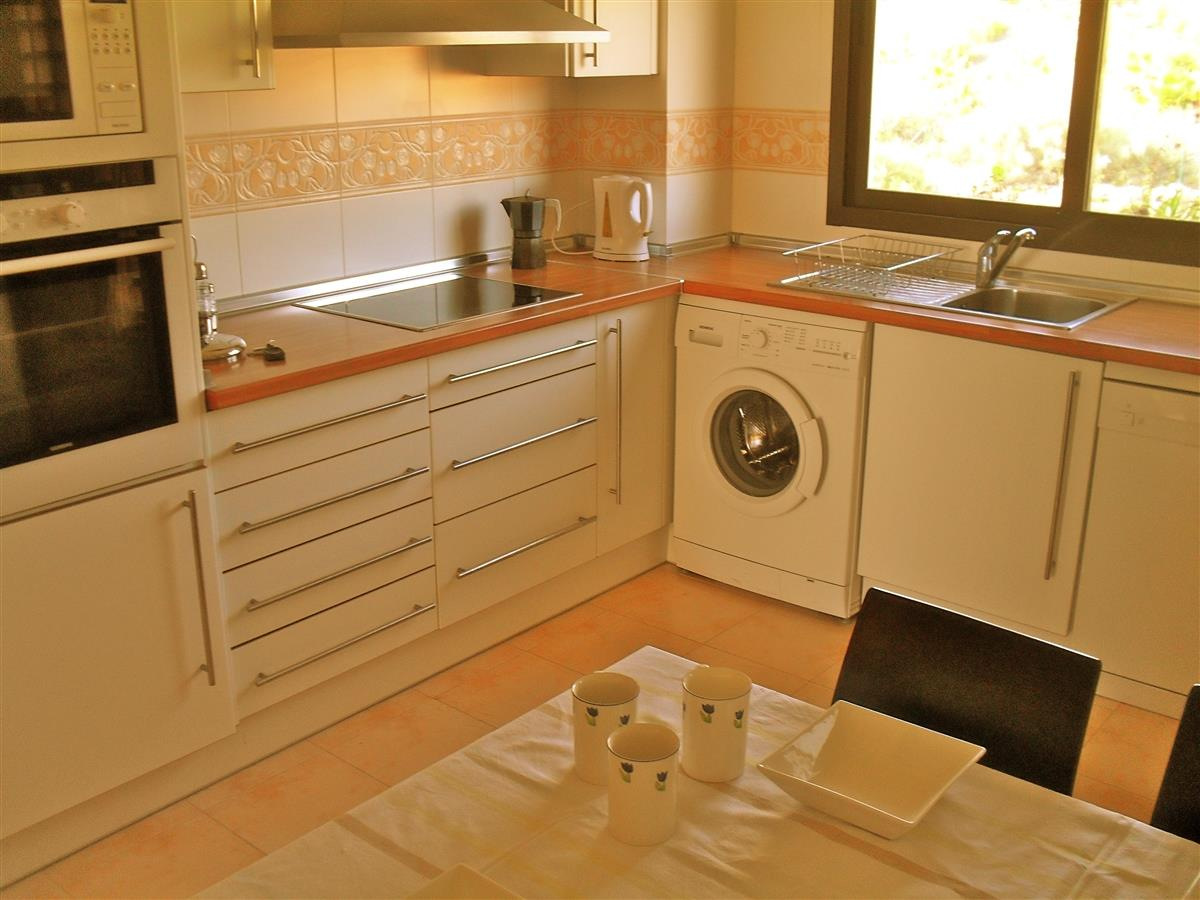 Spacious well-equipped kitchen with breakfast table