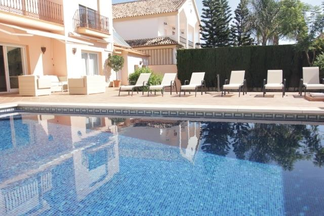 Private pool with terrace and sun loungers