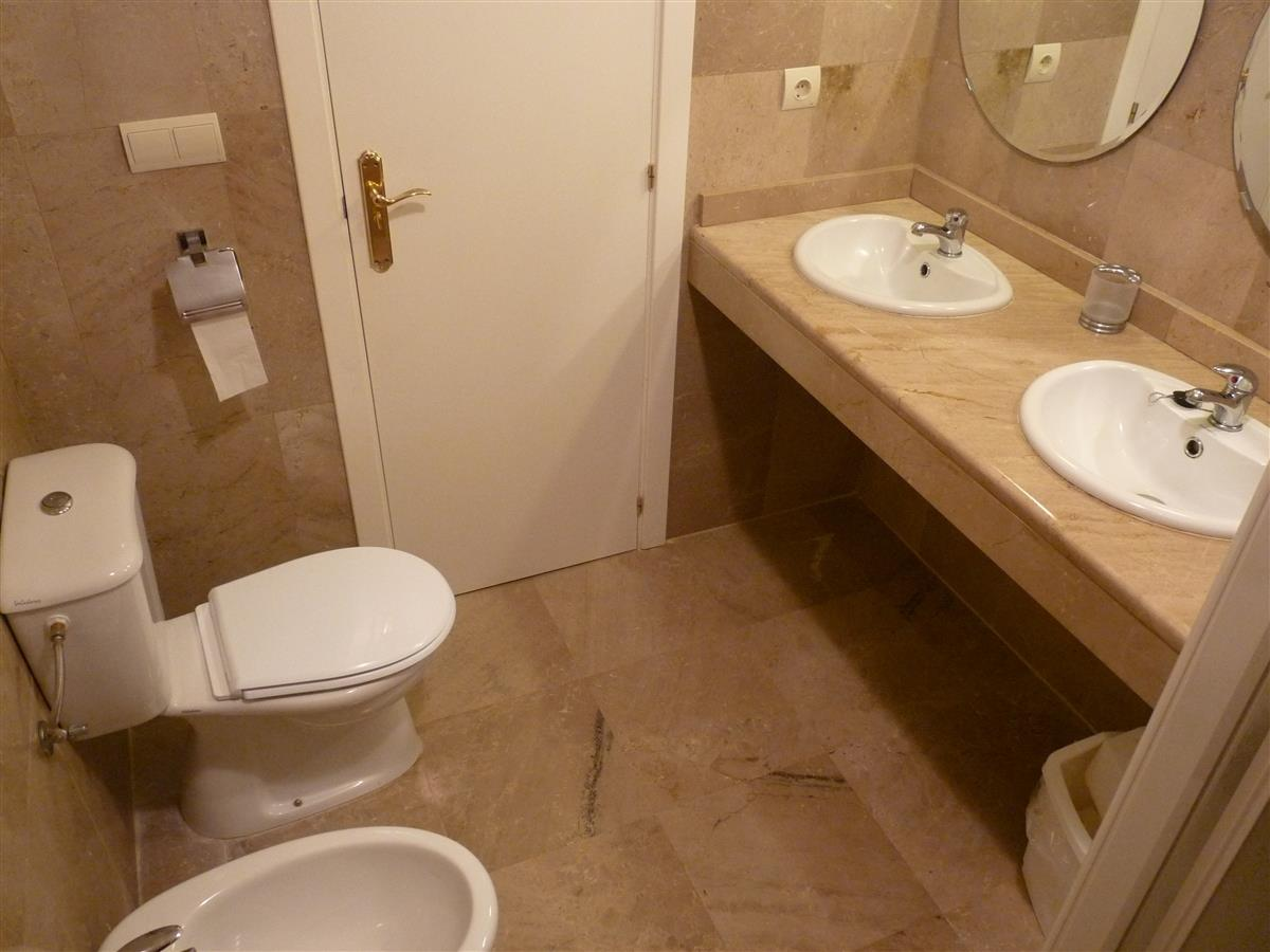 Main bathroom with his and hers sinks & separate shower cubicle