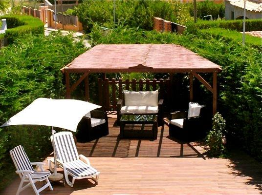 Pergola, relaxing sofa area & decking around private pool