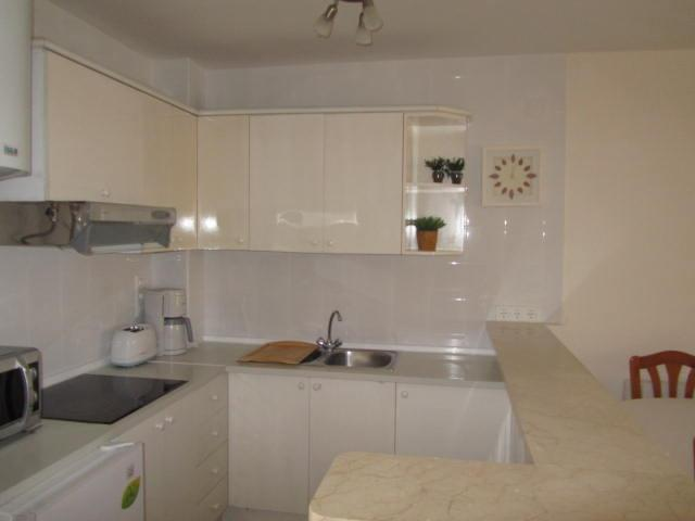 marble work top,halogen hob,extractor,coffee maker, etc.