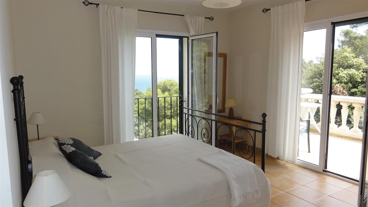 master bedroom top floor. Ensuite bathroom and terrace. Sea views