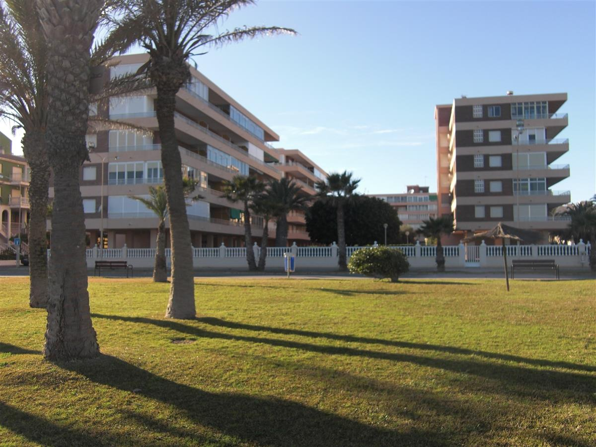 A View Towards Apartments from Seafront and Grass Front