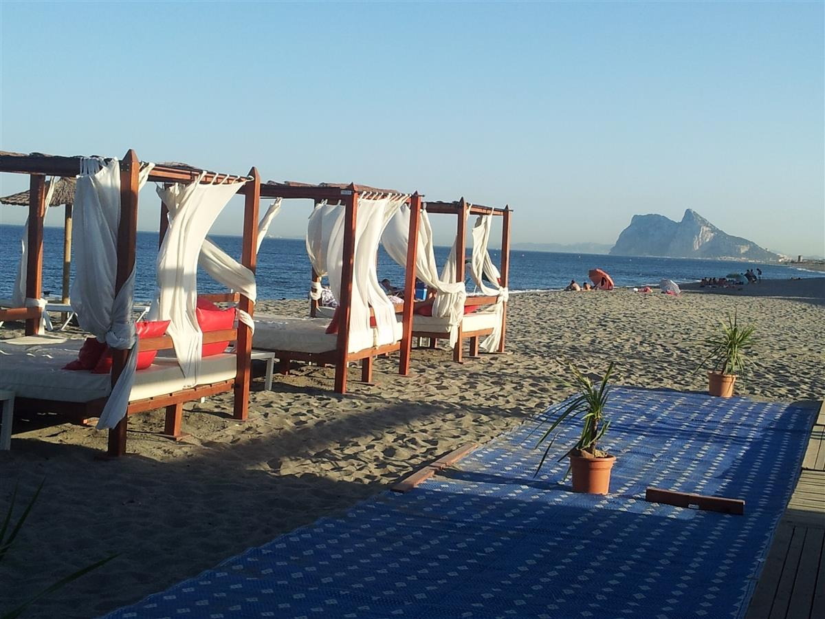 Enjoy a sundowner on Alcaidesa Beach