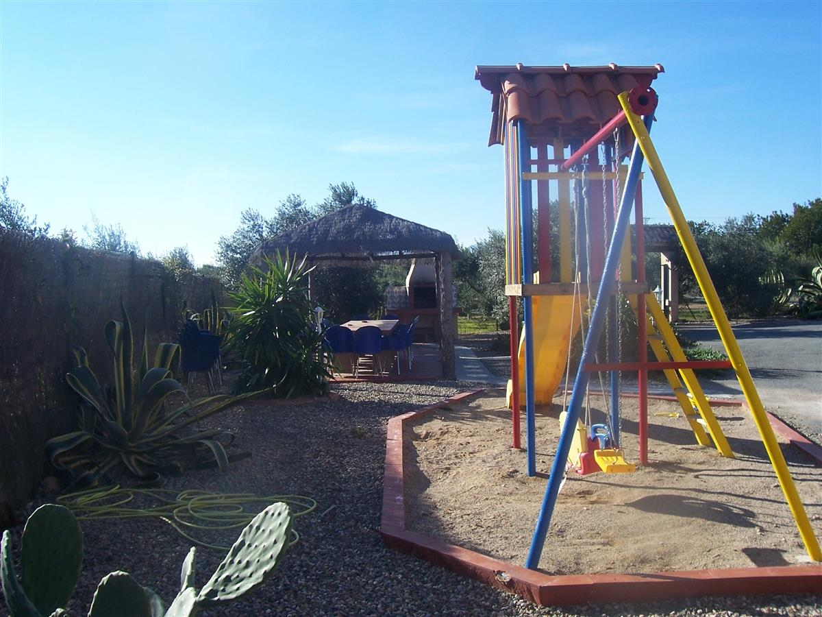 Childrens Playground with picnic area and bbq in background