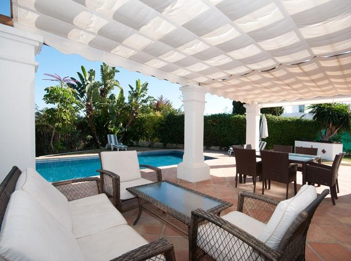 Covered terrace with lounge area in family villa near to San Pedro