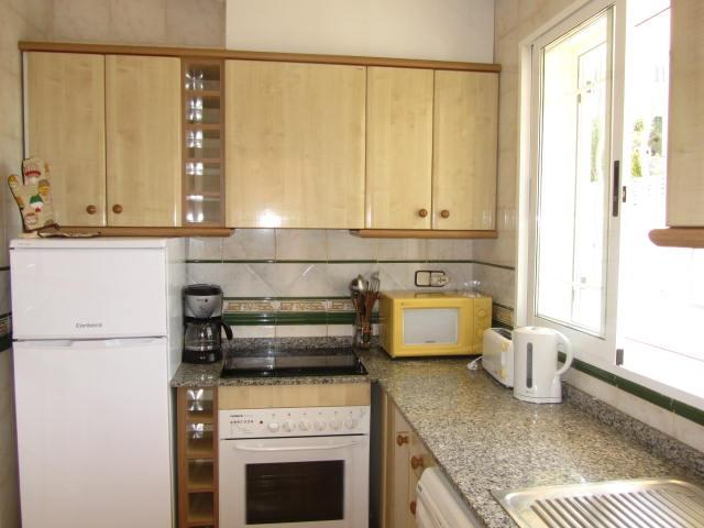 Fully equipped kitchen,door to back terrace & private garden