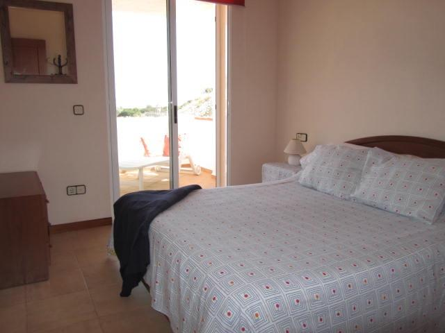 Bedroom 1.Large double bed,fitted wardrobe,storage,private balcony