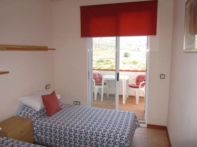 Bedroom 2 ,single beds x 2, fitted wardrobes,balcony with seating