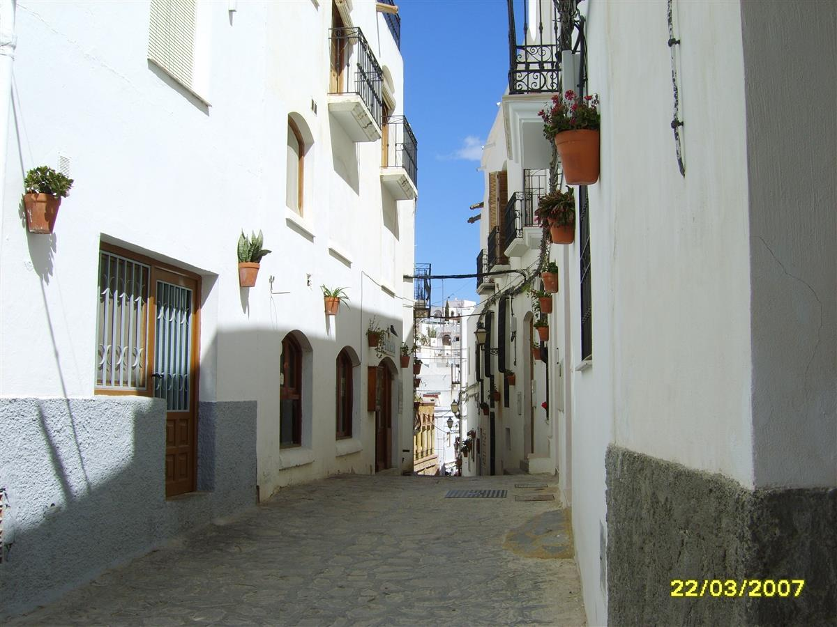 Walking through Mojacar Pueblo cobbled streets