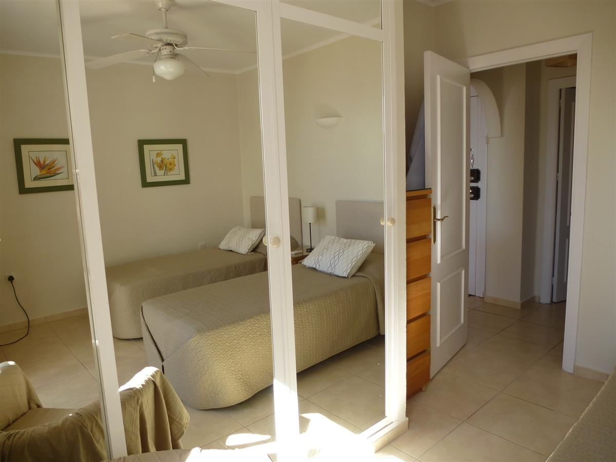 Twin bedroom which has views to the