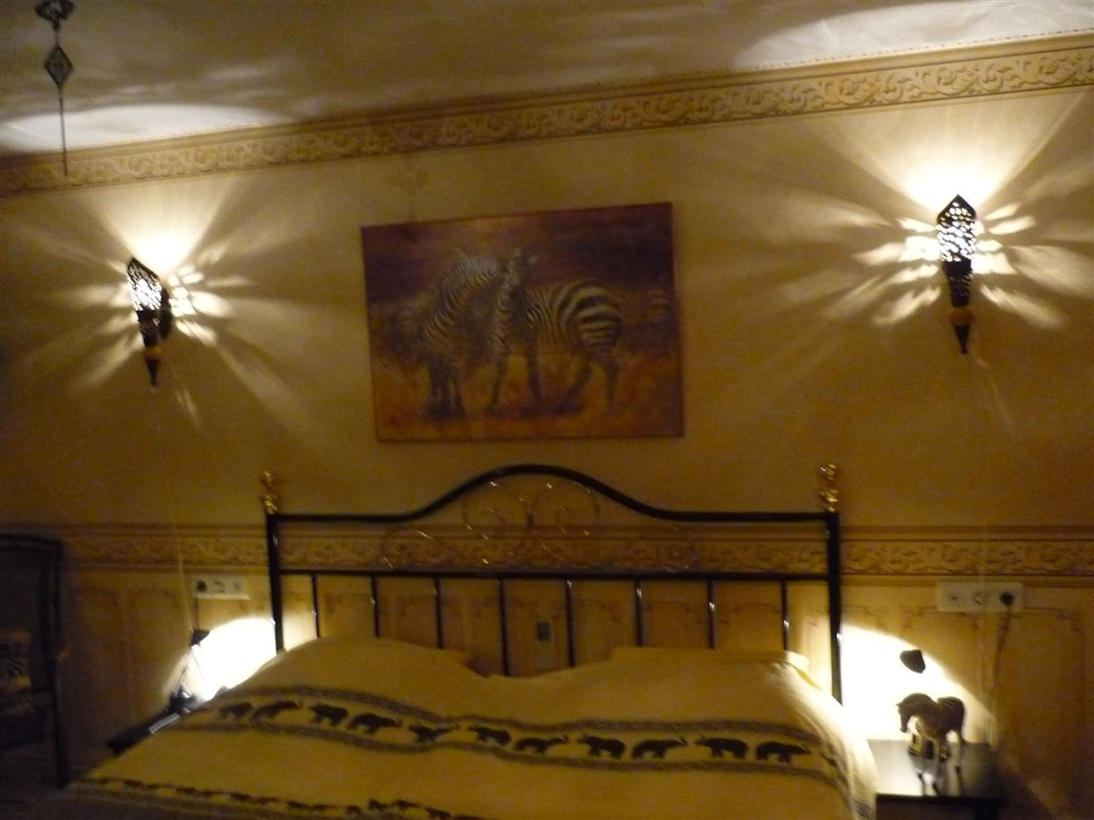 "The ""African""downstairs bedroom."