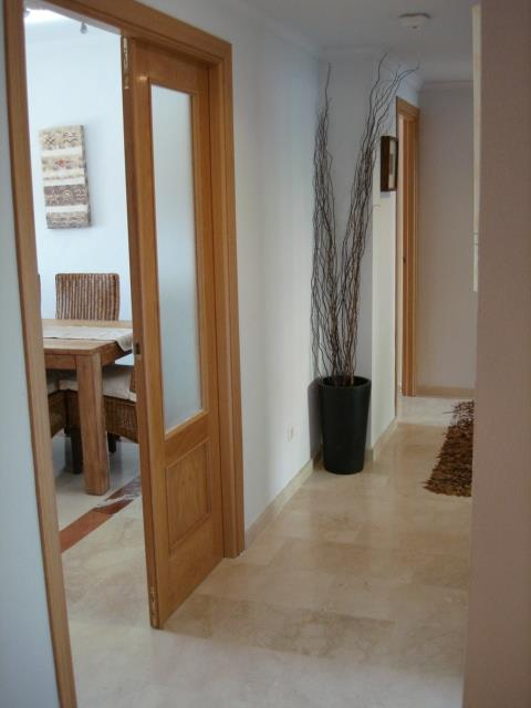 The Hallway leading to Living Room, Bedrooms and Kitchen