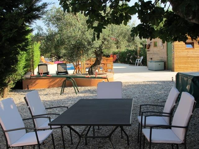 Dining terrace under fig tree