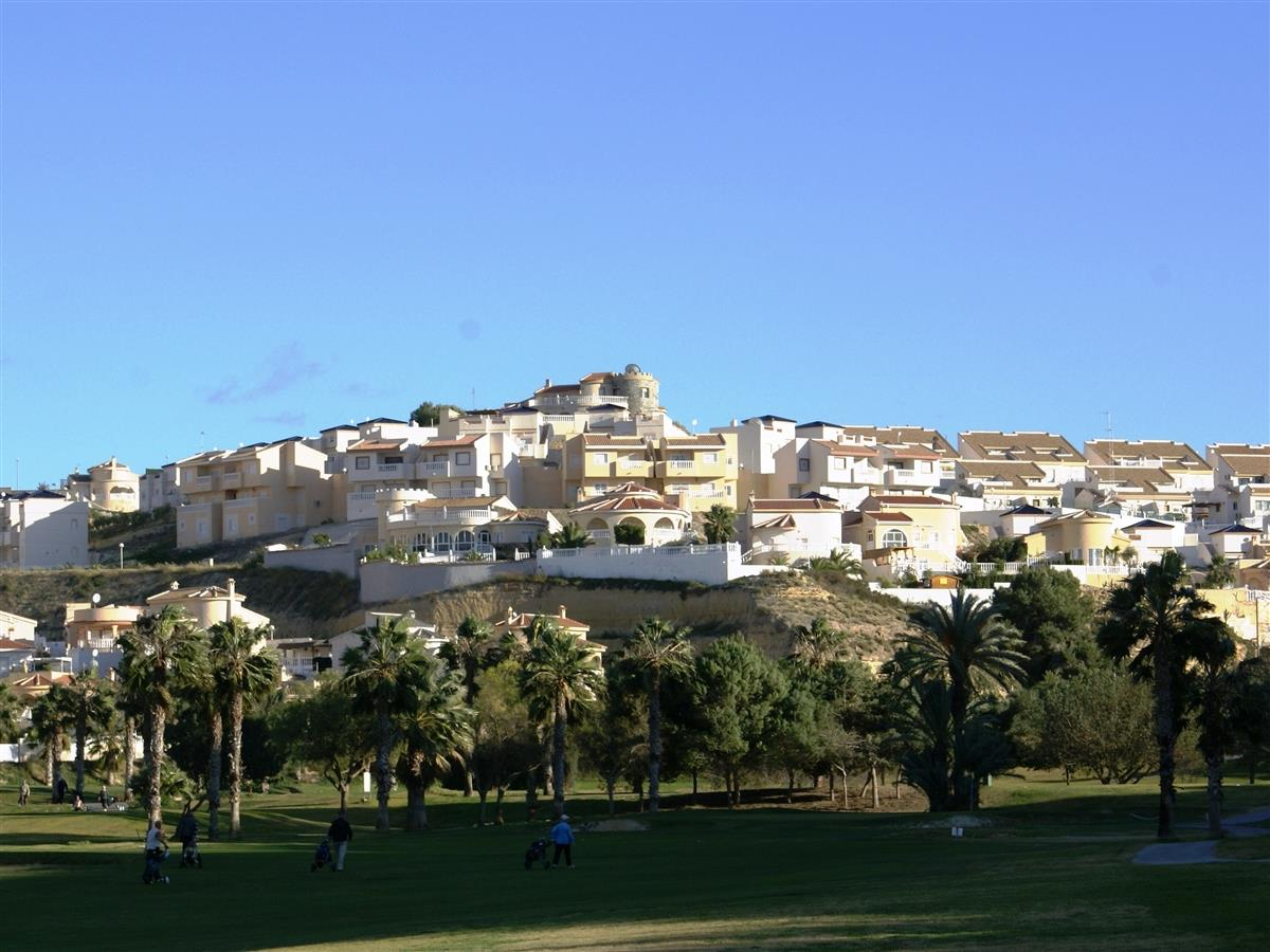 Holiday apartments on hill-side (middle, second row)