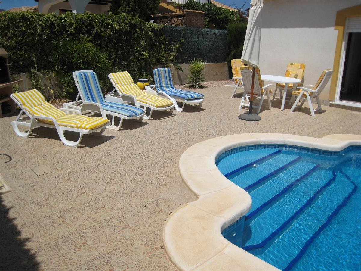 Relax by the pool in the hot Mazarron sun