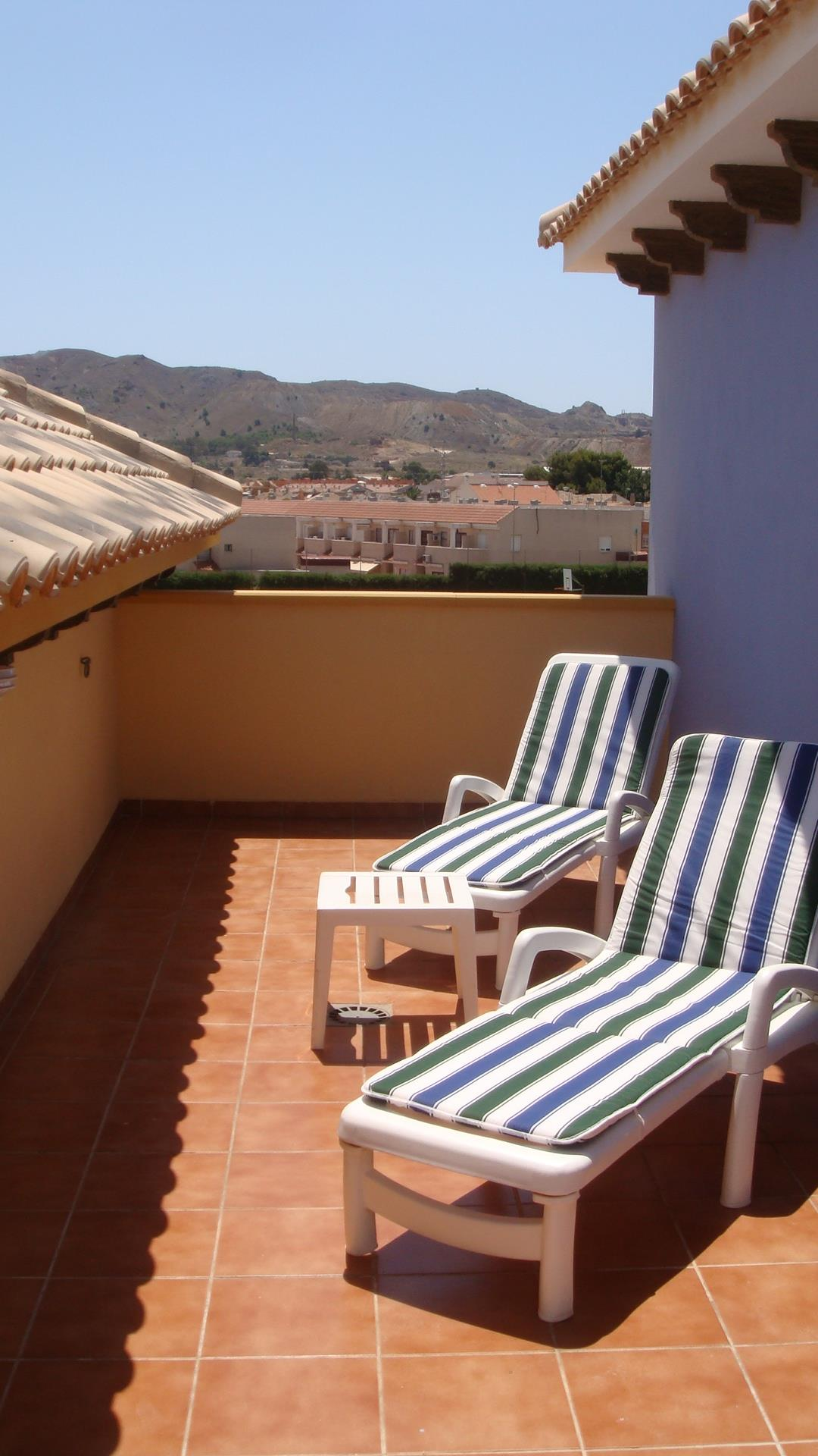 solarium with sunbeds and views to the Sierra Minera and La Union