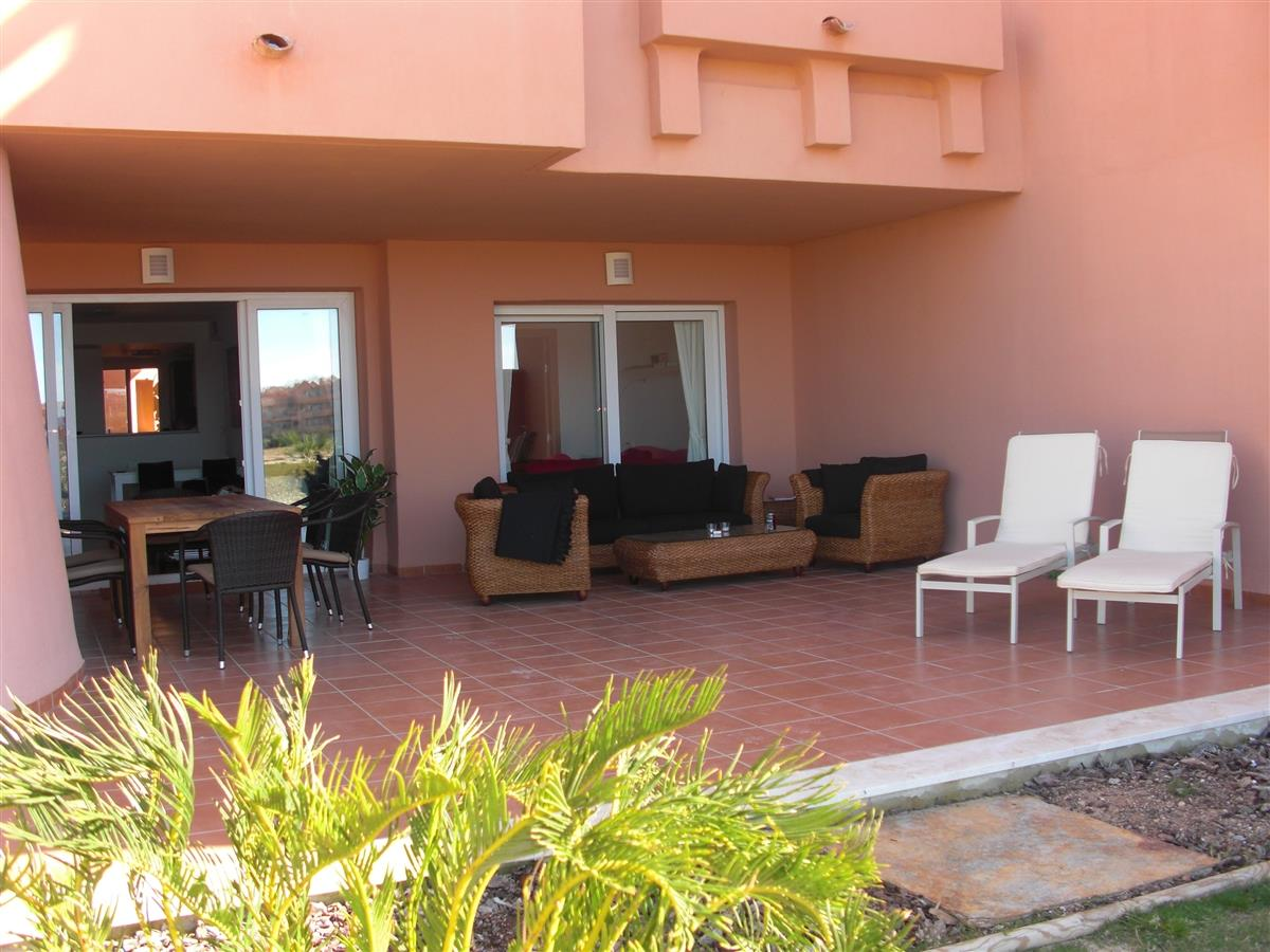 Terrace with dinning table, lounge funiture and sun beds.
