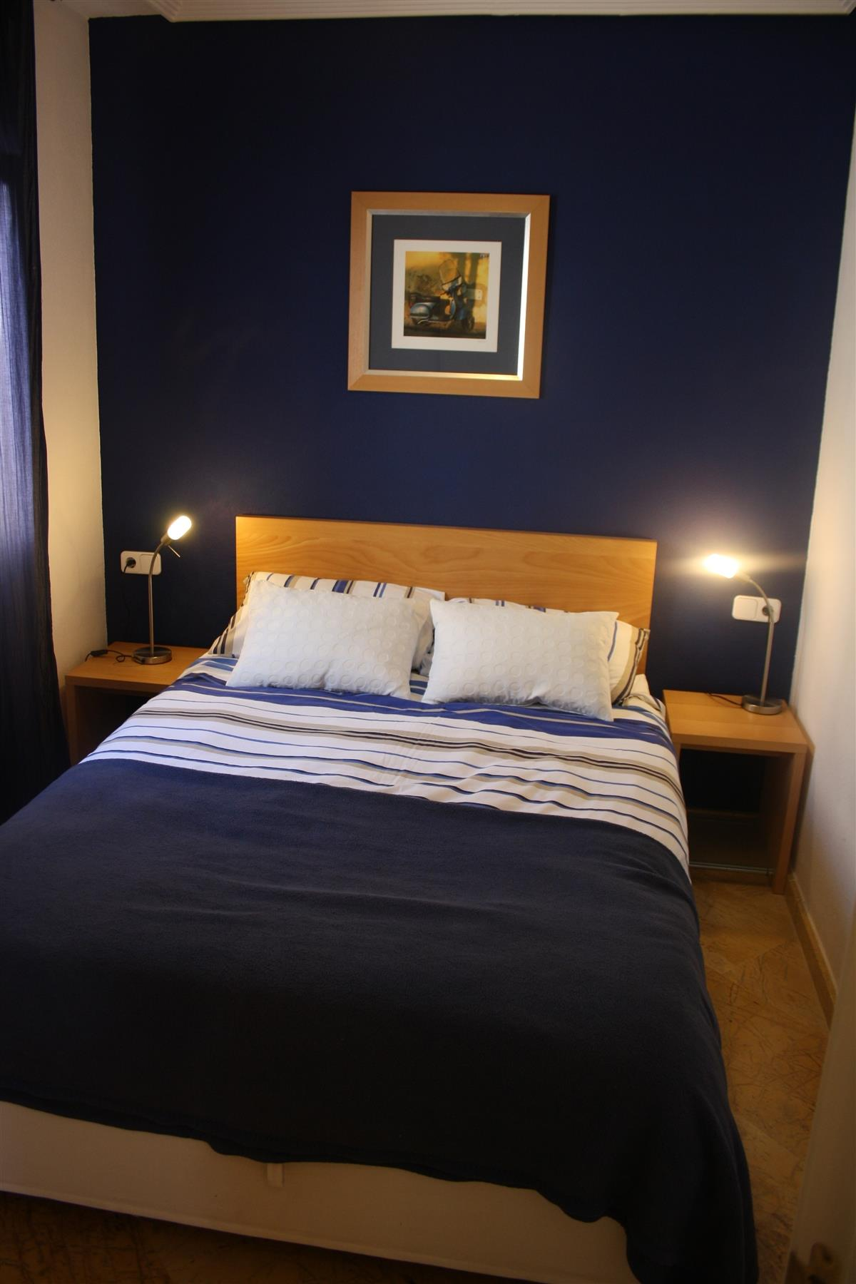 Blue double room with storage bed
