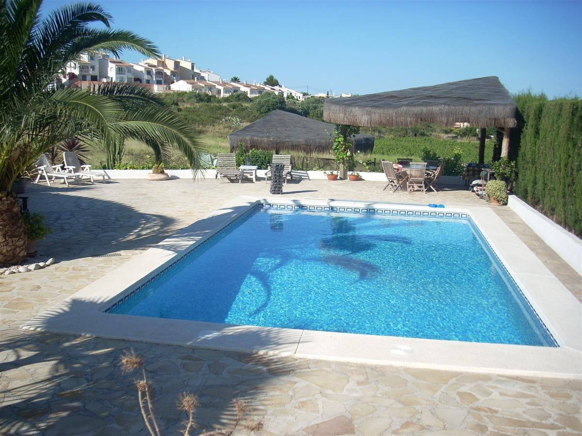 Swimming pool with large flat private terraced area.Shaded cabana.
