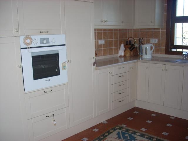 Modern kitchen, electric hob, oven, and microwave, fridge freezer