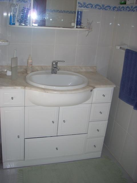 Garden room bathroom has good storage,fully tiled, walk-in shower