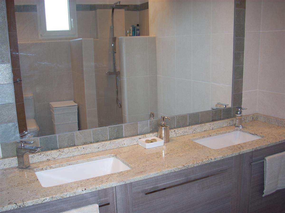 Double sink units with plenty of storage in family bathroom