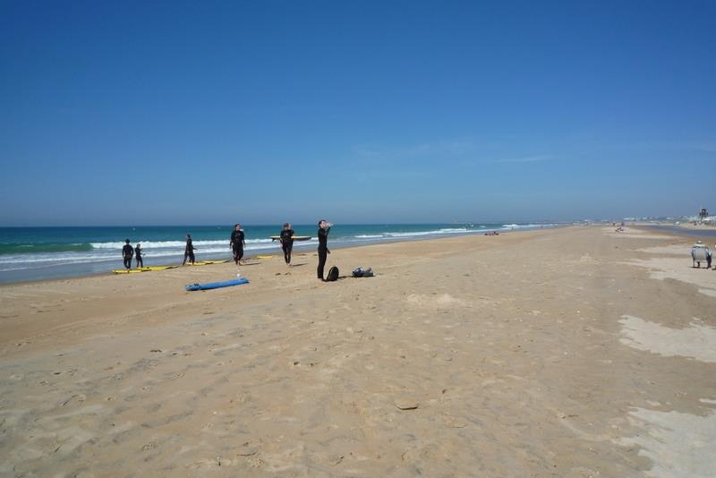 A surf school get ready on the clean, quiet beach at EL Palmar