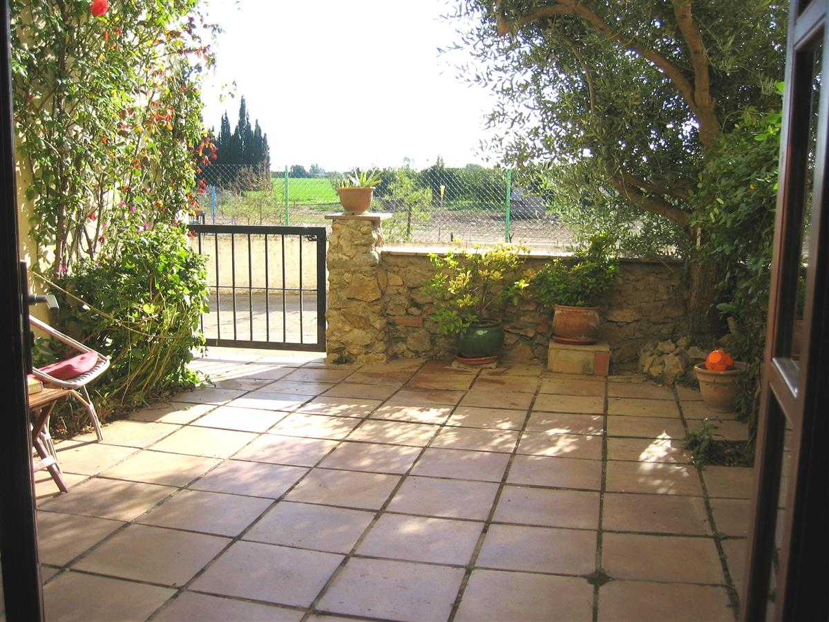 The small, private patio, ideal for meals outside and sunbathing.
