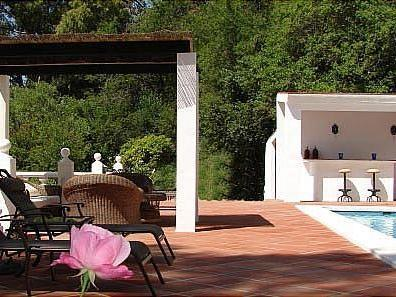 Lounge area by the pool of Finca Valtocado in Andalusia