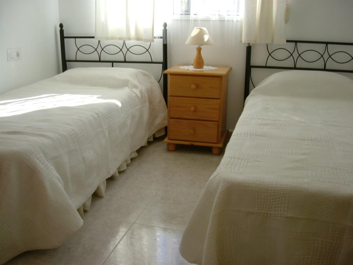 one of the 3 twin bedded bedrooms in large villa
