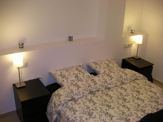 Bedroom with one double bed, fitted wardobe