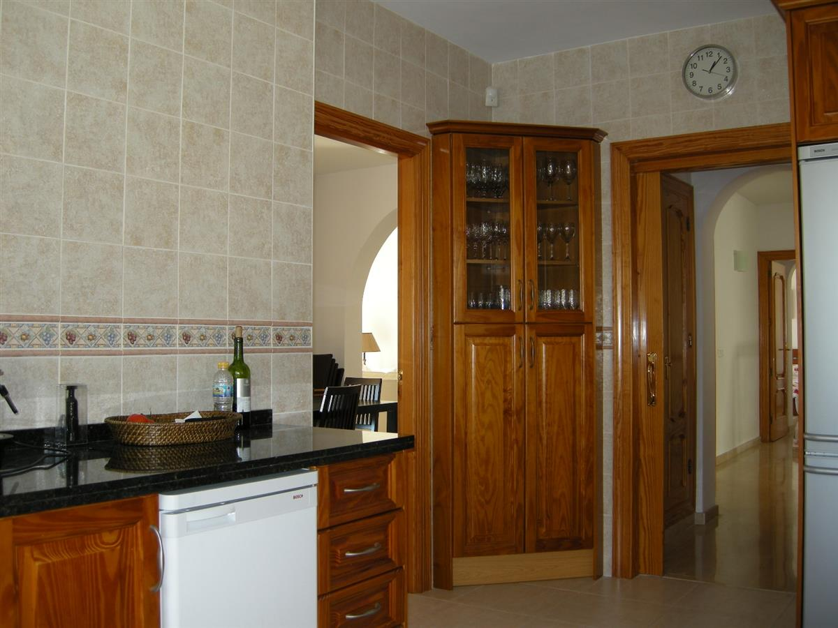 kitchen showing access to dining area and hall