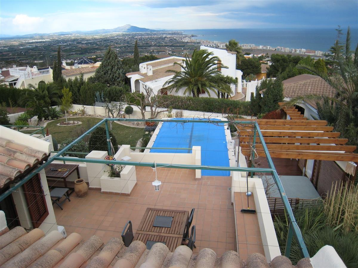 View on terrace, garden, pool and coast