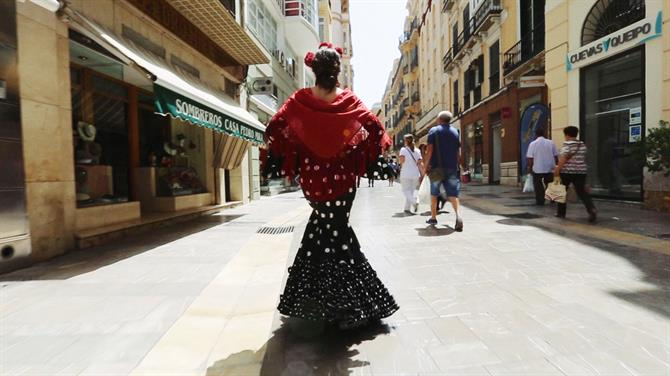 Woman at Malaga Feria in a Flamenco Dresses