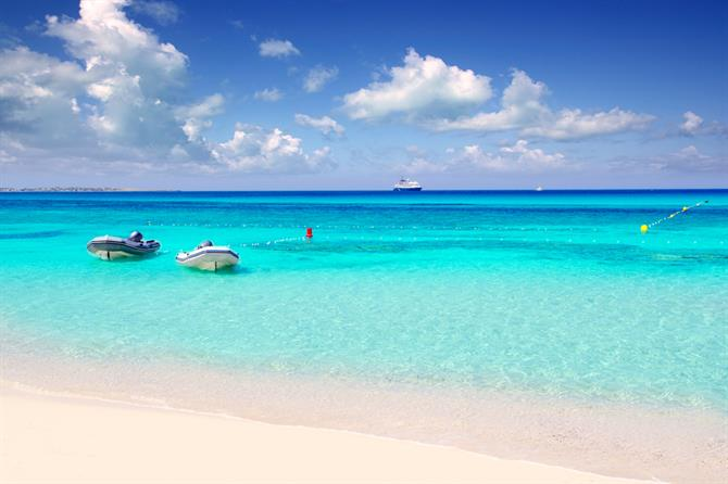 Pink sand and turquoise waters on Ses Illetas beach, Formentera