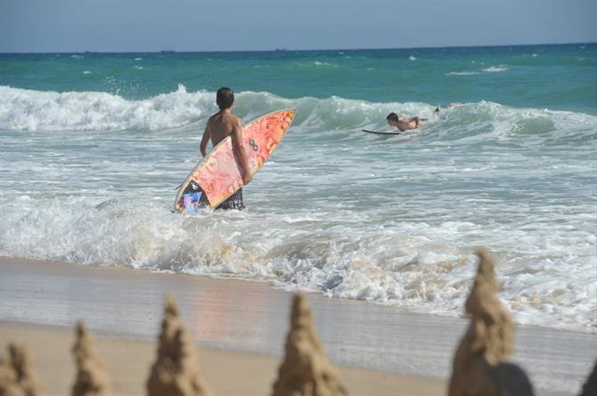 Children surfing on playa de Atlanterra
