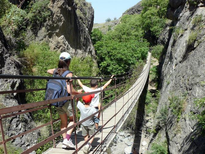 Crossing the hanging bridges of Monachil, Granada