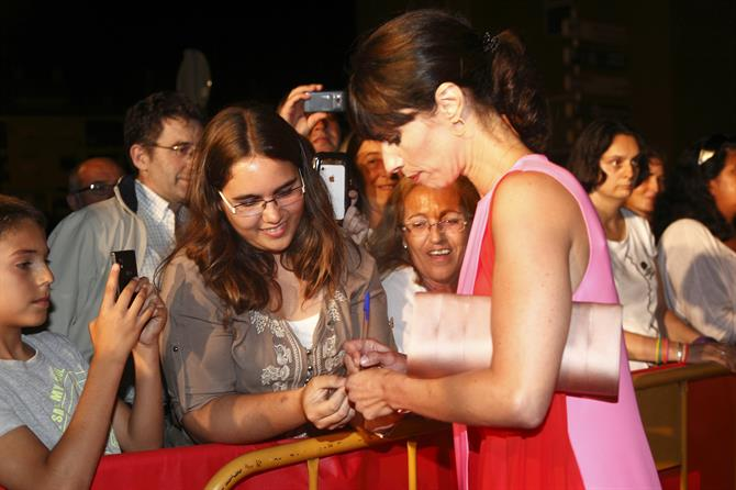 Actress Maribel Verdu signs autographs on the red carpet at Alfaz del Pi film festival