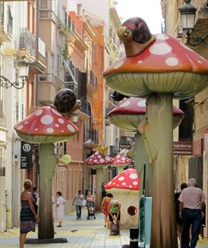 Calle San Francisco, Alicante, with childlike giant mushrooms