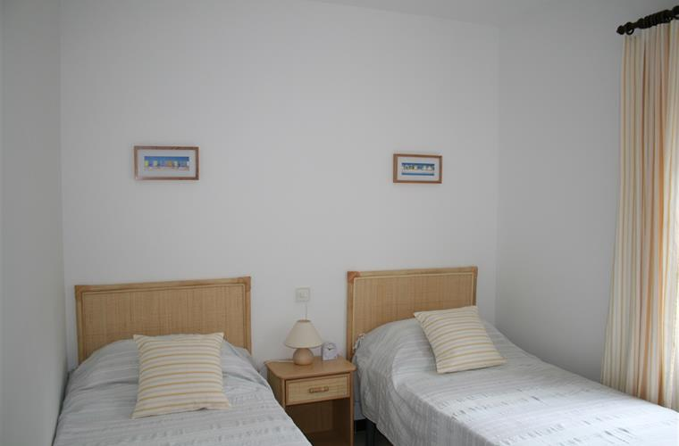 The 3rd bedroom has two single beds
