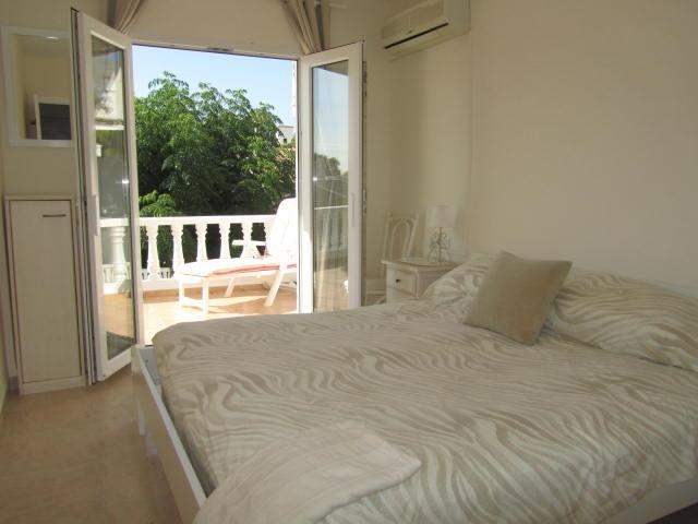 Master bedroom ,Ex.large bed,fitted wardrobes,Aircon,balcony.